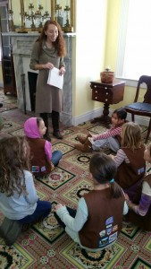 Brownies seated in parlor